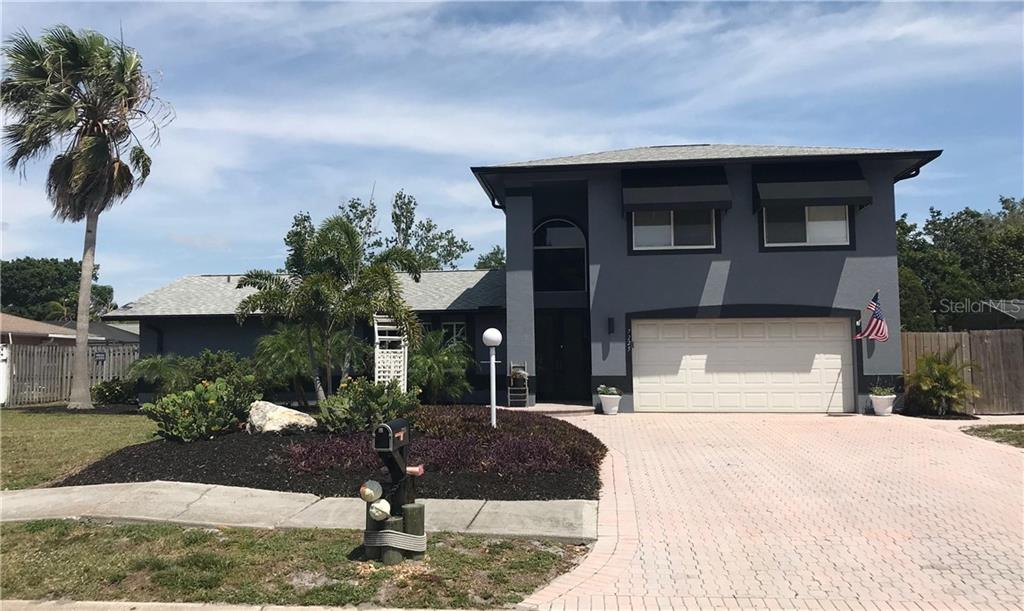 Single Family Home for sale at 7225 Caladesia Dr, Sarasota, FL 34243 - MLS Number is A4433399