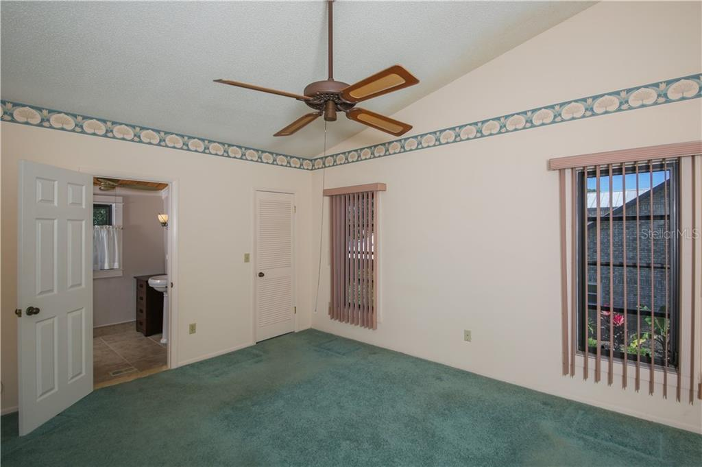 Bedroom 2 w/walk in closet and large bathroom - Single Family Home for sale at 7611 Alhambra Dr, Bradenton, FL 34209 - MLS Number is A4434753