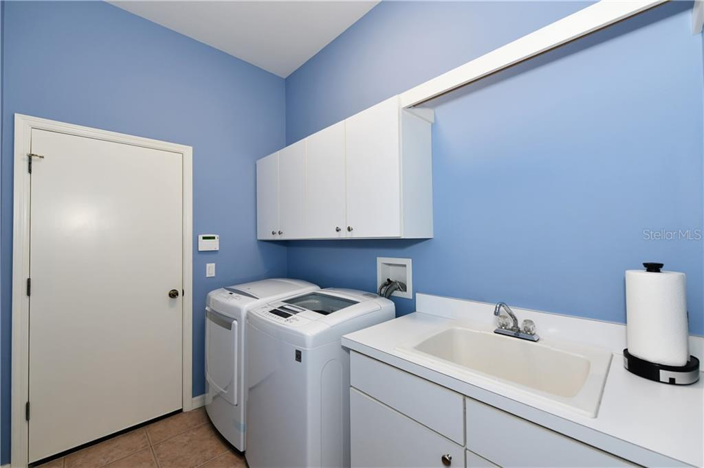Laundry center w/tub. Natural gas dryer, upper cabinets & hanging rack - Single Family Home for sale at 2745 Harvest Dr, Sarasota, FL 34240 - MLS Number is A4436381