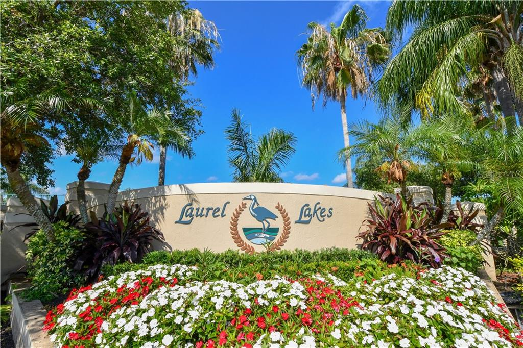 Lush entry landscaping - Single Family Home for sale at 2745 Harvest Dr, Sarasota, FL 34240 - MLS Number is A4436381