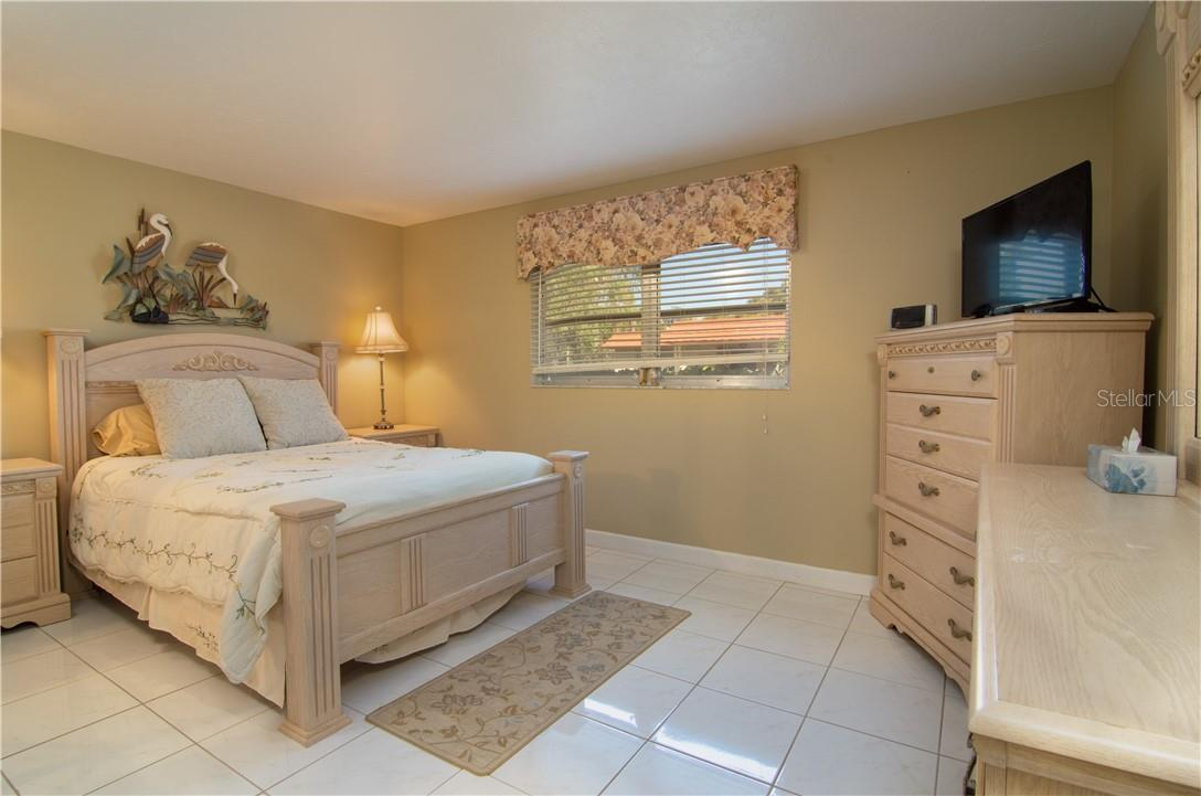 Master Bedroom & Opening to the Bathroom - Villa for sale at 4820 Gulf Of Mexico Dr, Longboat Key, FL 34228 - MLS Number is A4436854