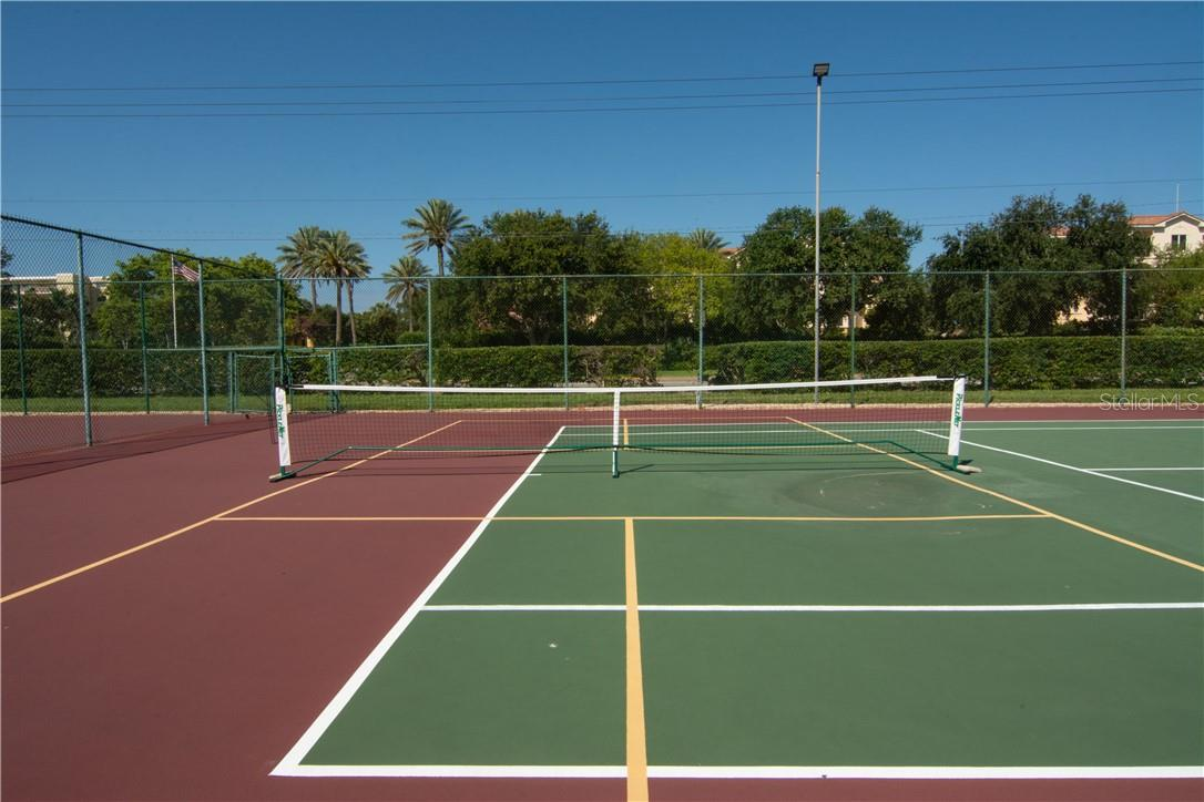 Tennis Court Overlooking the Vegetation - Villa for sale at 4820 Gulf Of Mexico Dr, Longboat Key, FL 34228 - MLS Number is A4436854