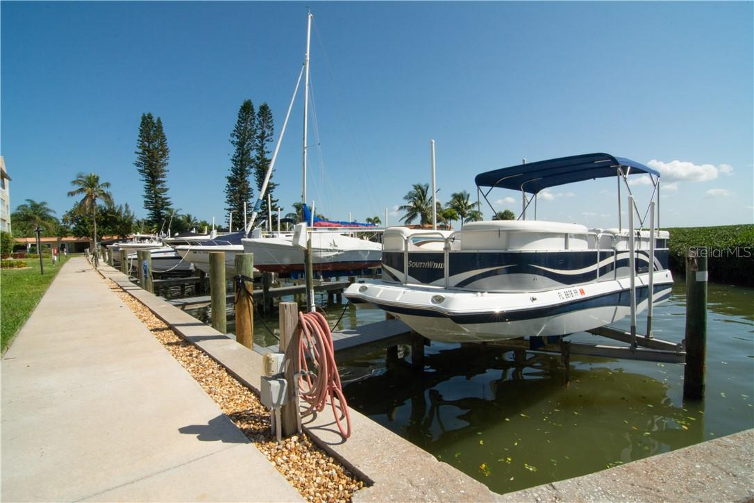 Marina Overlooking the Building - Villa for sale at 4820 Gulf Of Mexico Dr, Longboat Key, FL 34228 - MLS Number is A4436854