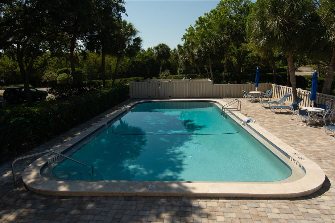 Swimming Pool by the Parking Area - Villa for sale at 4820 Gulf Of Mexico Dr, Longboat Key, FL 34228 - MLS Number is A4436854