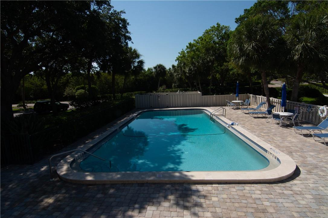 Swimming Pool and the Building - Villa for sale at 4820 Gulf Of Mexico Dr, Longboat Key, FL 34228 - MLS Number is A4436854