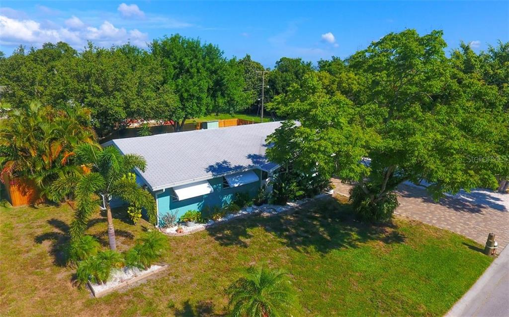 View from the southeast corner of the lot. - Single Family Home for sale at 120 23rd Street Ct Ne, Bradenton, FL 34208 - MLS Number is A4438232