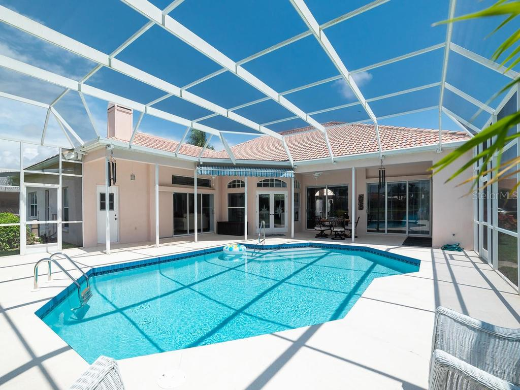 Look at all of the sliding doors!  Door on left is the pool bath. - Single Family Home for sale at 4117 Via Mirada, Sarasota, FL 34238 - MLS Number is A4438764