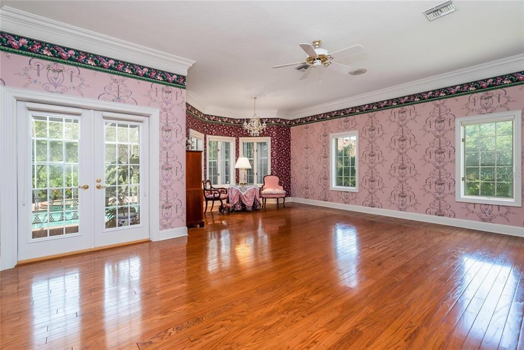 Expansive master suite with reading nook, double French doors to covered lanai, beautiful wood floors, and lots of windows for natural lights. - Single Family Home for sale at 3702 Beneva Oaks Blvd, Sarasota, FL 34238 - MLS Number is A4438878