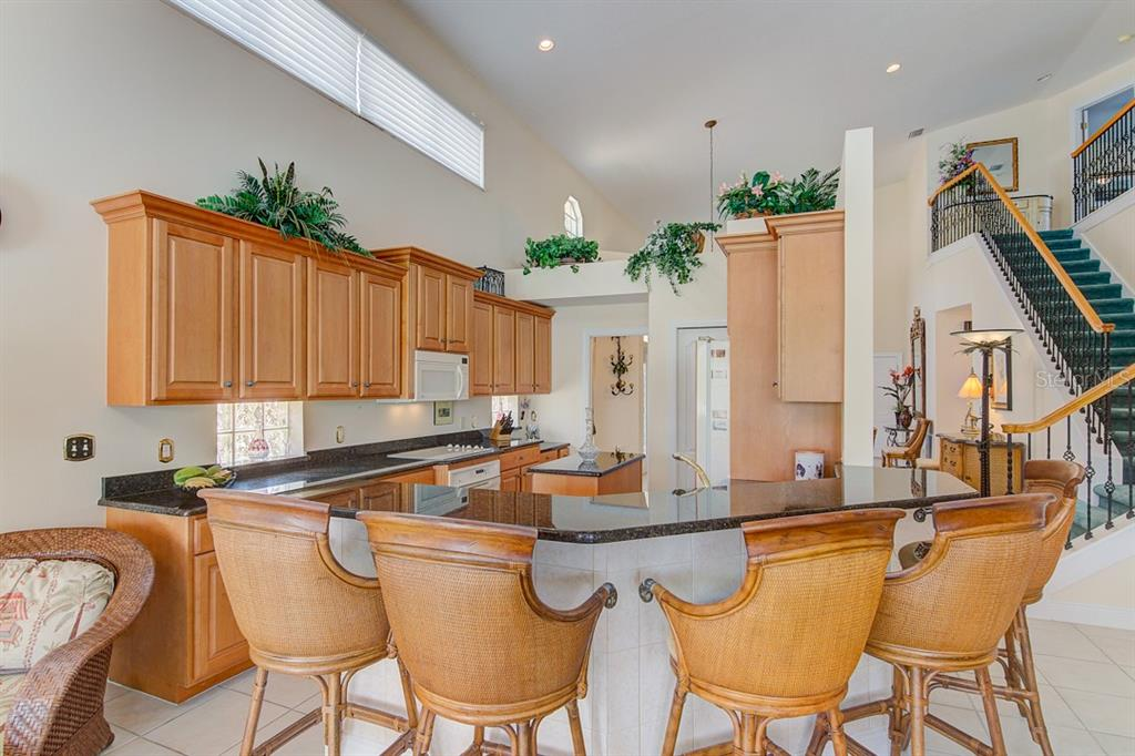 Breakfast Bar View - Single Family Home for sale at 811 Jungle Queen Way, Longboat Key, FL 34228 - MLS Number is A4438987