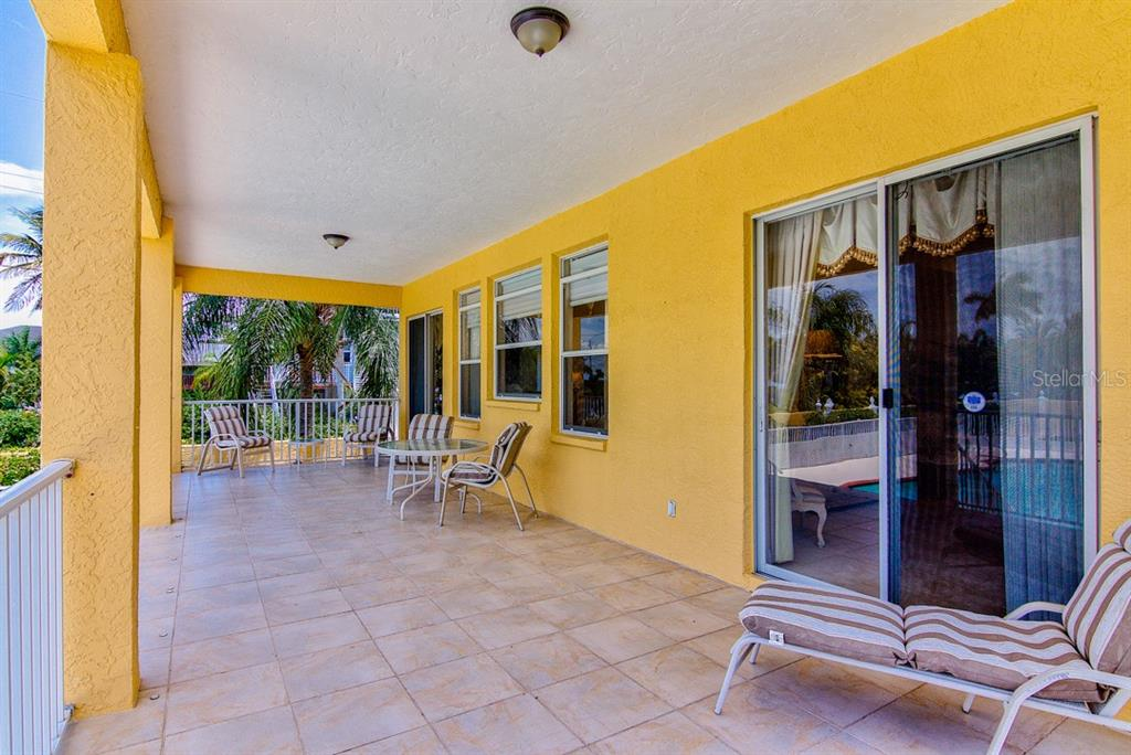 First Floor Patio - Single Family Home for sale at 811 Jungle Queen Way, Longboat Key, FL 34228 - MLS Number is A4438987