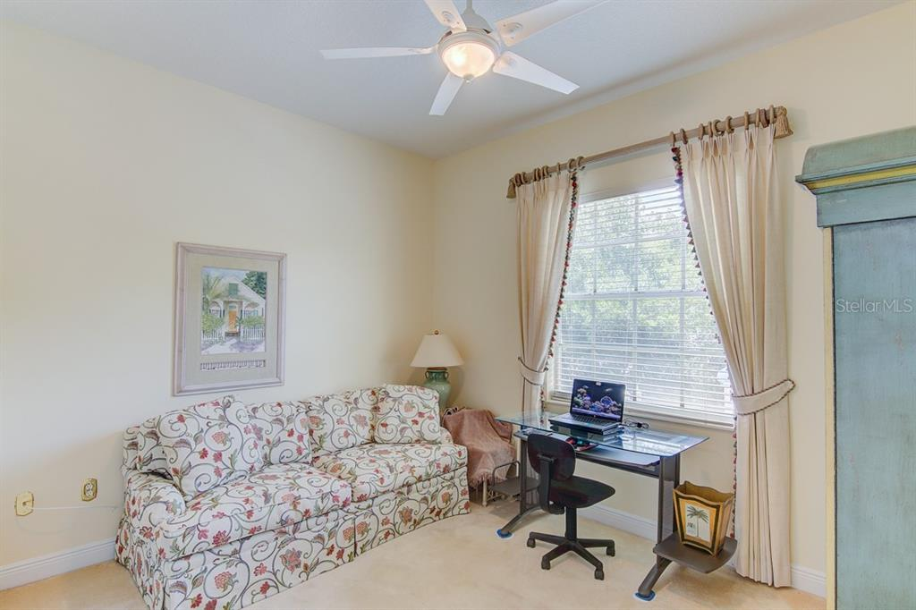 1st Floor Guest Bedroom - Single Family Home for sale at 811 Jungle Queen Way, Longboat Key, FL 34228 - MLS Number is A4438987