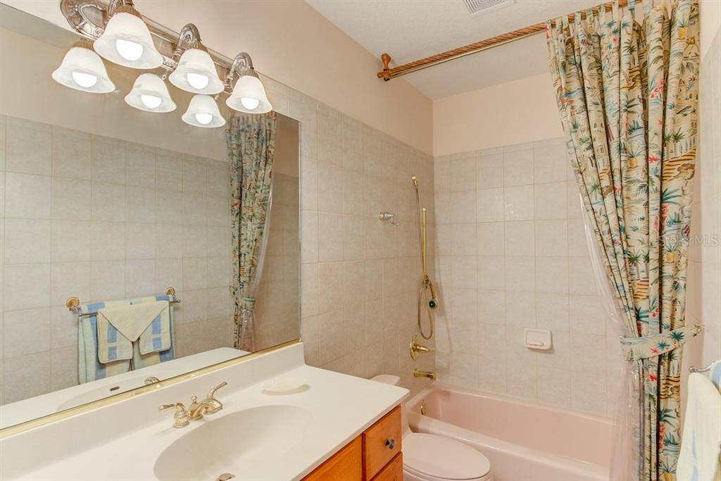 1st Floor Guest Bathroom - Single Family Home for sale at 811 Jungle Queen Way, Longboat Key, FL 34228 - MLS Number is A4438987