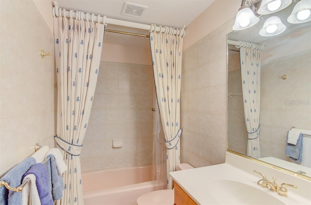 Guest Bathroom - Single Family Home for sale at 811 Jungle Queen Way, Longboat Key, FL 34228 - MLS Number is A4438987