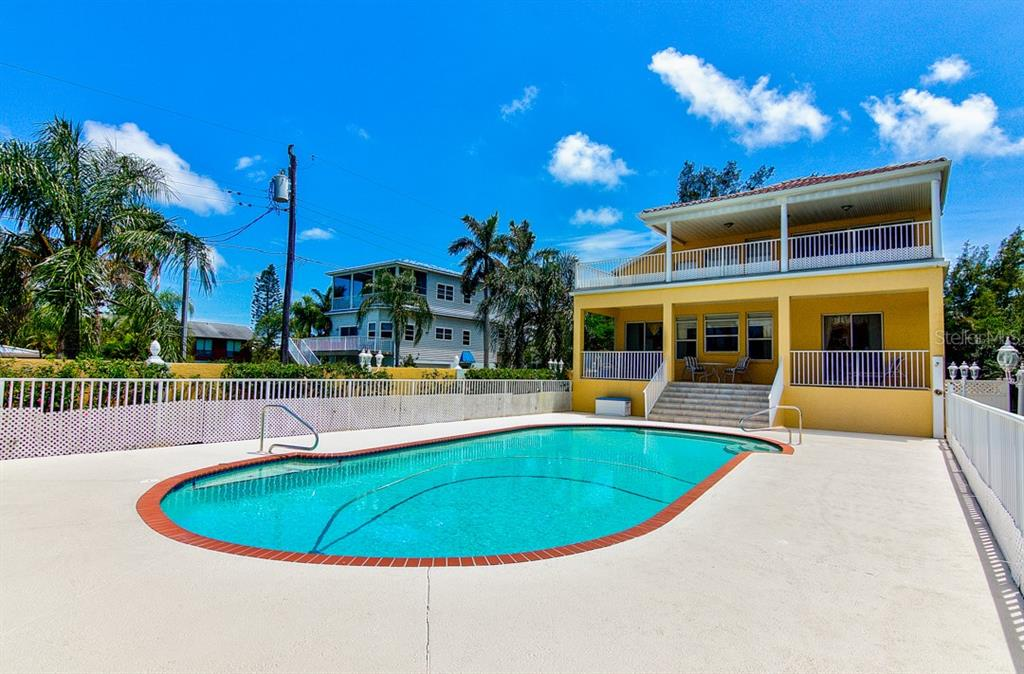 Single Family Home for sale at 811 Jungle Queen Way, Longboat Key, FL 34228 - MLS Number is A4438987