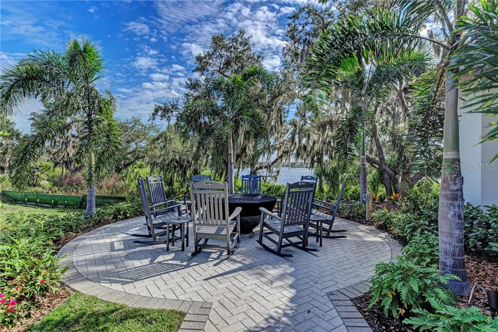 Fire Pit located just off the side of the Clubhouse. - Single Family Home for sale at 11728 Rive Isle Run, Parrish, FL 34219 - MLS Number is A4439074