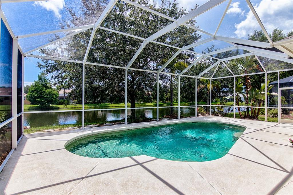 Pool with Lake View - Single Family Home for sale at 6562 Field Sparrow Gln, Lakewood Ranch, FL 34202 - MLS Number is A4441603