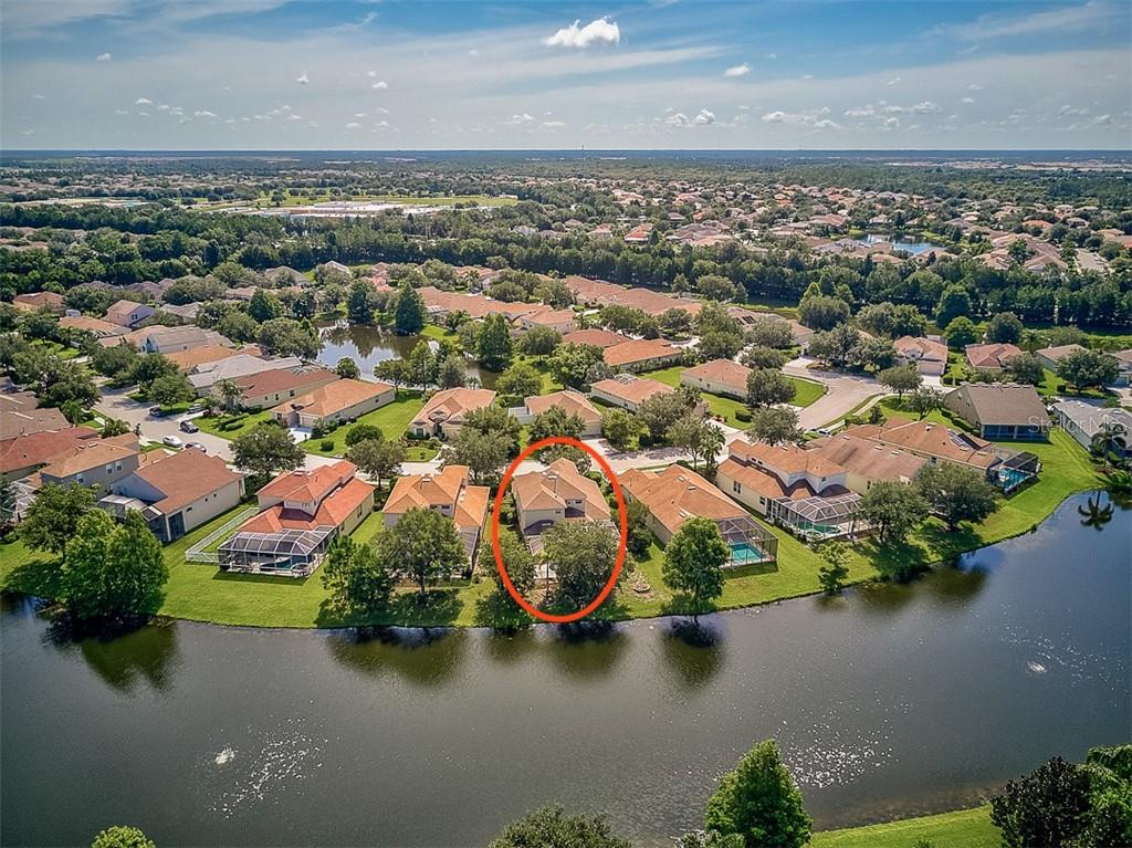 Aerial back and lake - Single Family Home for sale at 6562 Field Sparrow Gln, Lakewood Ranch, FL 34202 - MLS Number is A4441603