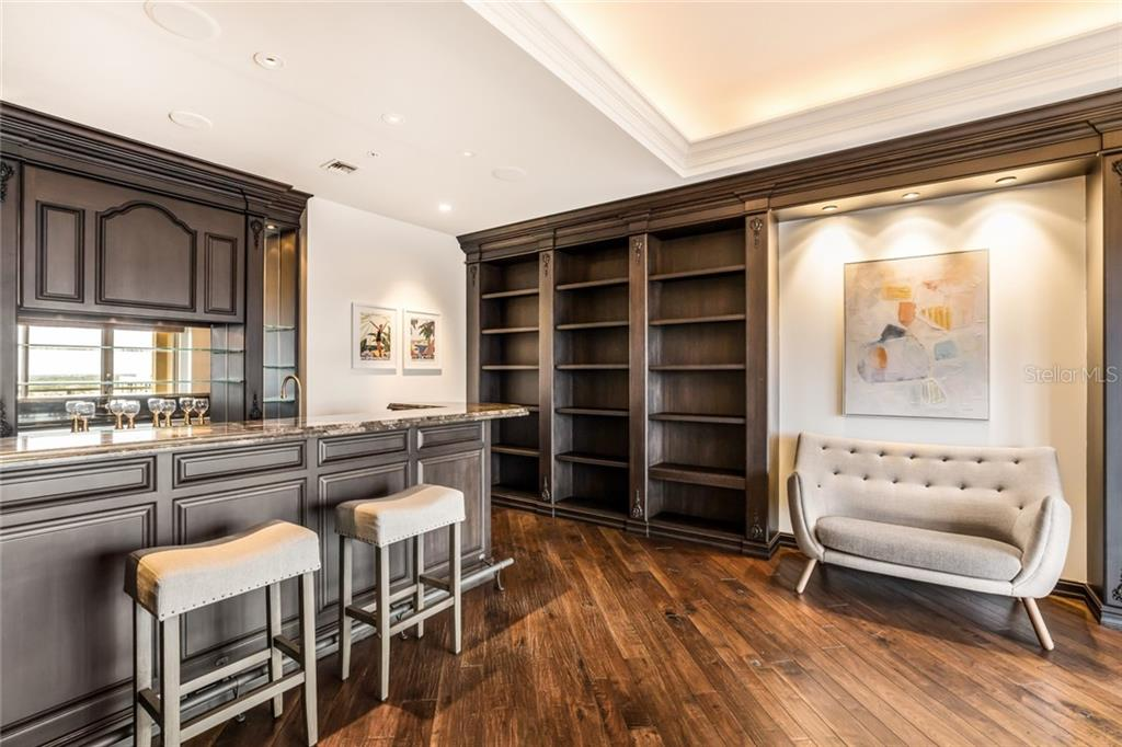 The luxurious library with wet bar is just off the living room. - Condo for sale at 1111 Ritz Carlton Dr #1704, Sarasota, FL 34236 - MLS Number is A4442192