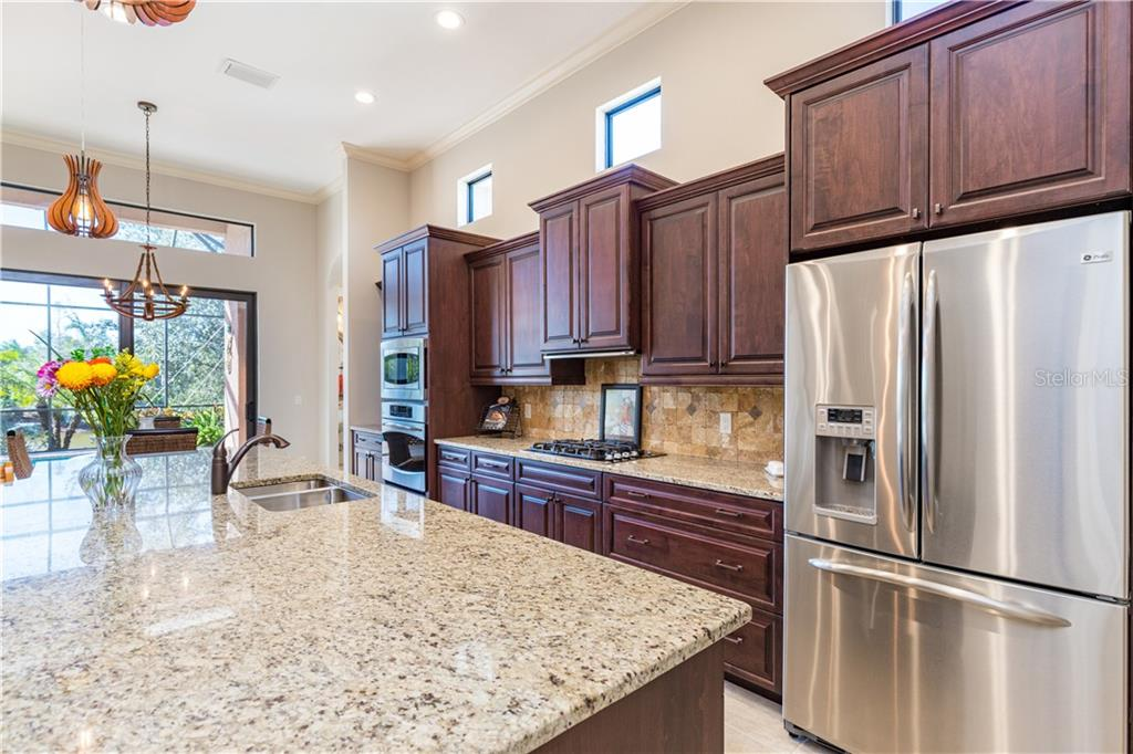 Beautiful wood cabinetry - Single Family Home for sale at 14710 Leopard Creek Pl, Lakewood Ranch, FL 34202 - MLS Number is A4442202