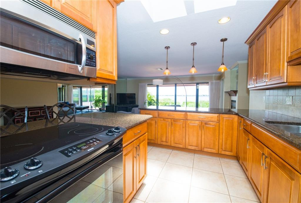 Enjoy bay views fro my your chef's kitchen. - Condo for sale at 4001 Catalina Dr, Bradenton, FL 34210 - MLS Number is A4443126