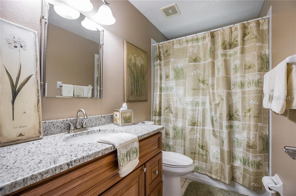 Main level guest bath - Single Family Home for sale at 128 41st Cir E, Bradenton, FL 34208 - MLS Number is A4443779