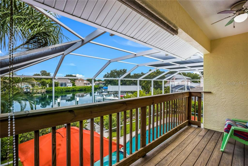 Master screened-in balcony - Single Family Home for sale at 128 41st Cir E, Bradenton, FL 34208 - MLS Number is A4443779