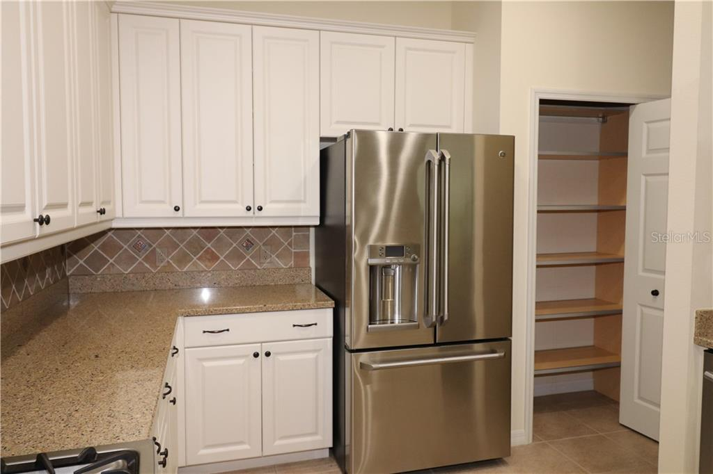 Wood and Stainless Pantry Shelves - Single Family Home for sale at 13896 Siena Loop, Lakewood Ranch, FL 34202 - MLS Number is A4444006
