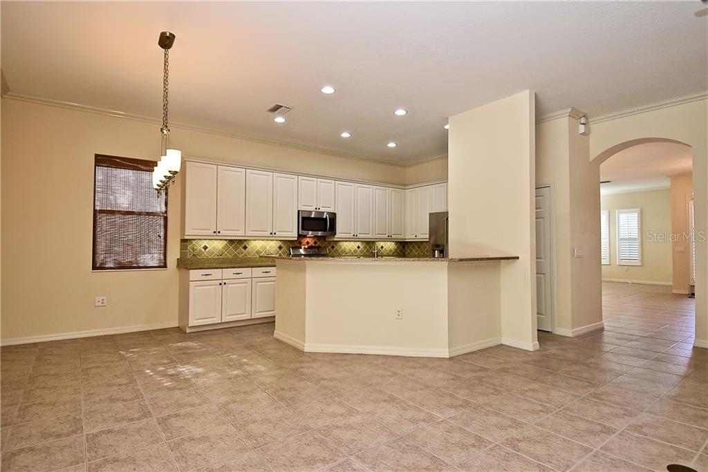 Breakfast Area and Kitchen  Open Floor Plan - Single Family Home for sale at 13896 Siena Loop, Lakewood Ranch, FL 34202 - MLS Number is A4444006