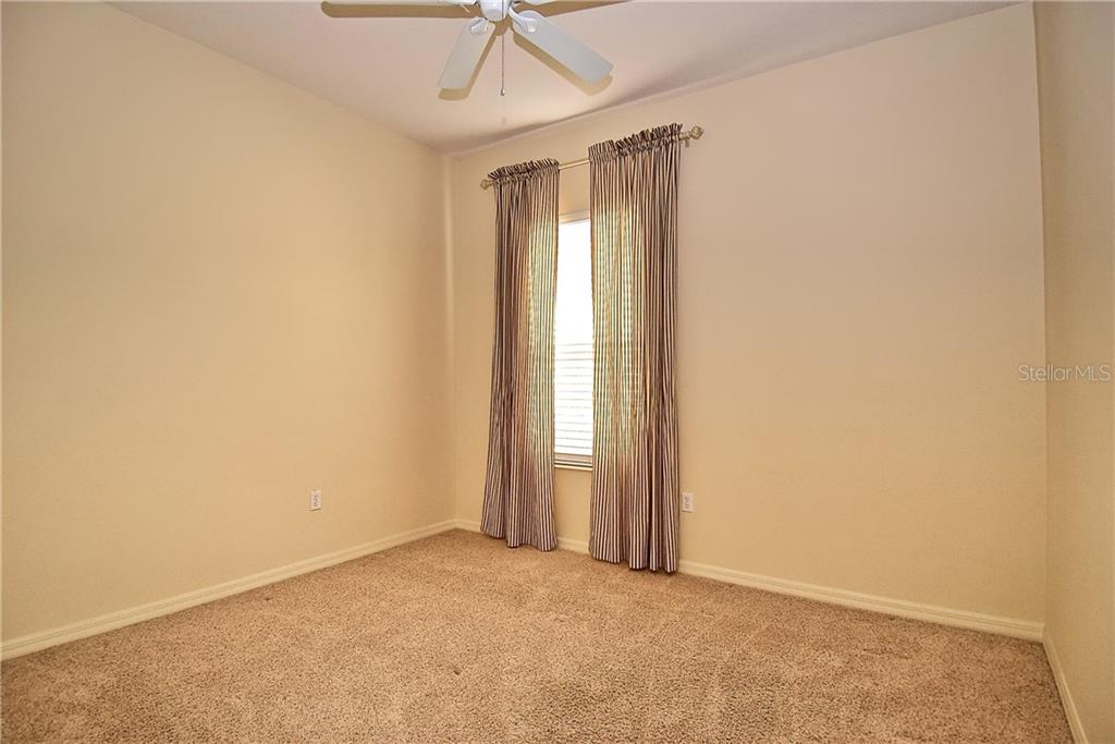 Guest Bedroom - Single Family Home for sale at 13896 Siena Loop, Lakewood Ranch, FL 34202 - MLS Number is A4444006