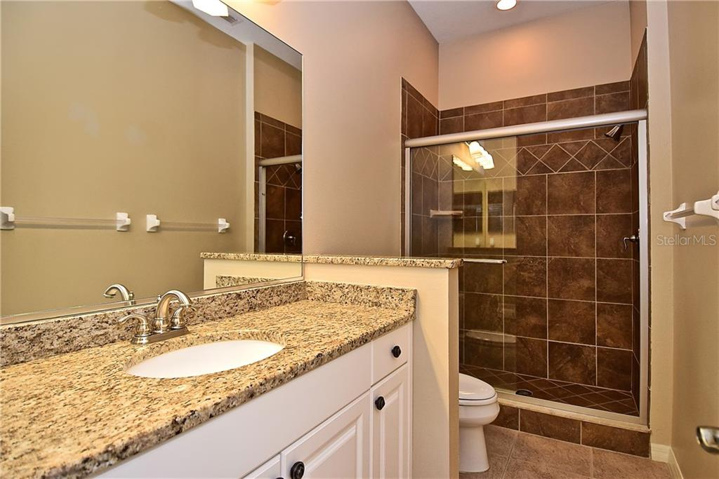 Guest Bathroom and Shower - Single Family Home for sale at 13896 Siena Loop, Lakewood Ranch, FL 34202 - MLS Number is A4444006