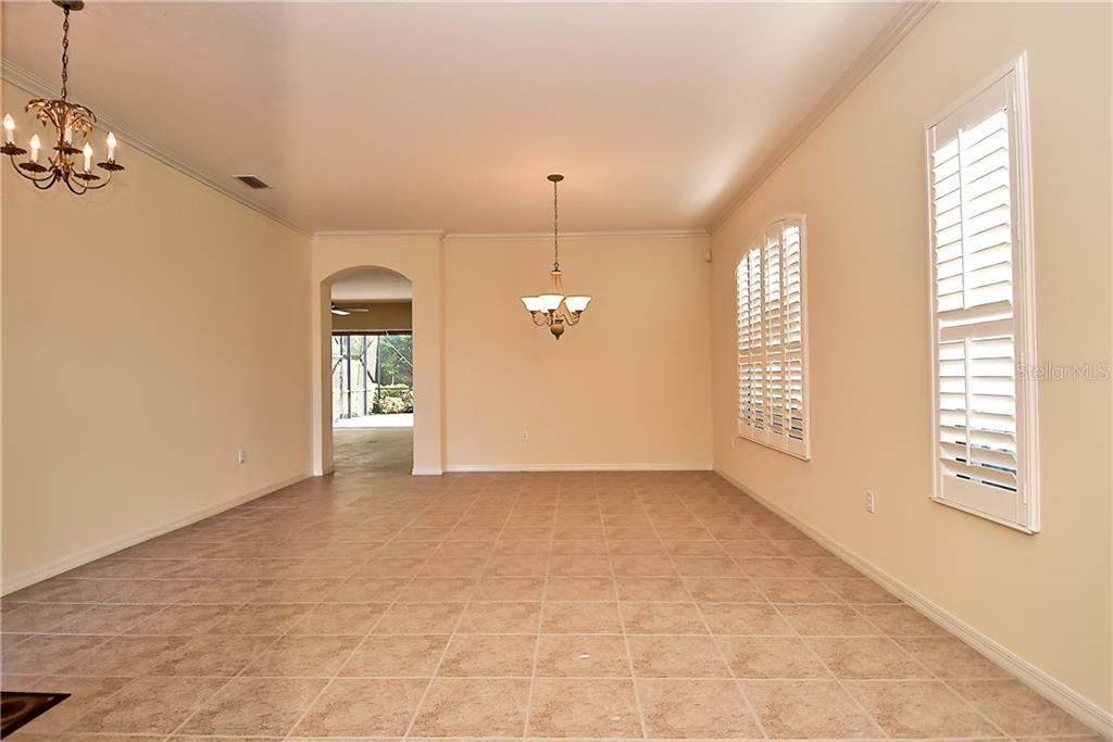 Living Room and Dining Room Area - Single Family Home for sale at 13896 Siena Loop, Lakewood Ranch, FL 34202 - MLS Number is A4444006