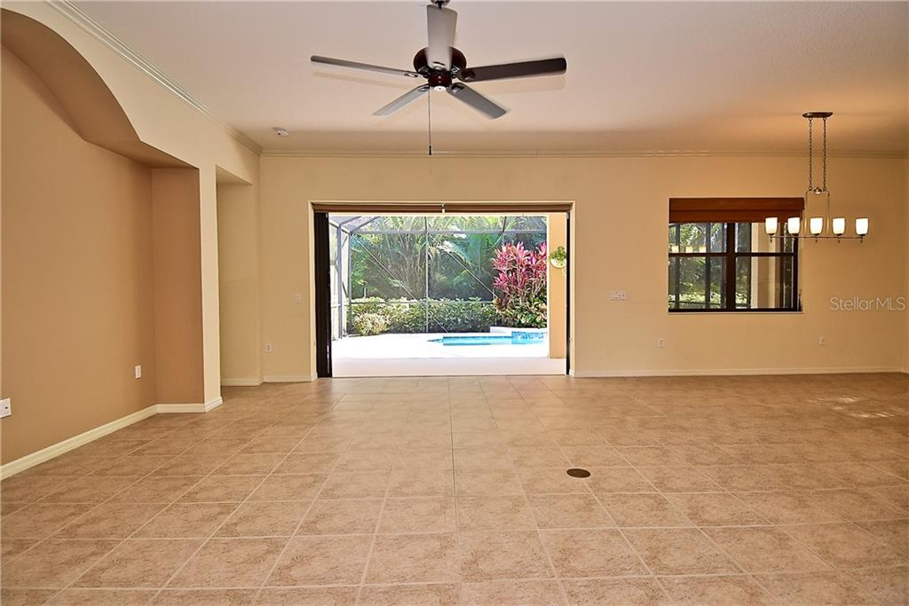 Family Room opens to Kitchen and Pool Area - Single Family Home for sale at 13896 Siena Loop, Lakewood Ranch, FL 34202 - MLS Number is A4444006