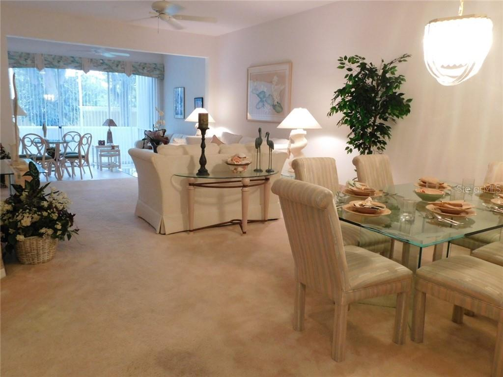 COMBINATION DINING AND LIVING AREA (GREAT ROOM) - Villa for sale at 6351 Stone River Rd, Bradenton, FL 34203 - MLS Number is A4444928
