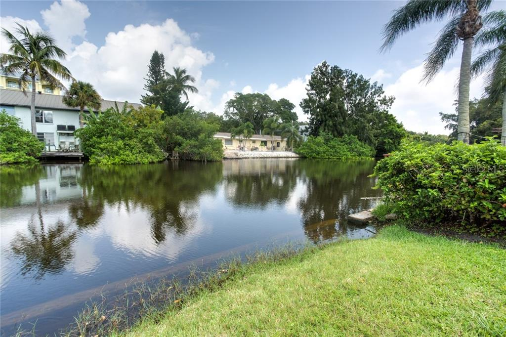 Canal /Lake in backyard. - Duplex/Triplex for sale at 6525 Sabal Dr, Sarasota, FL 34242 - MLS Number is A4445167