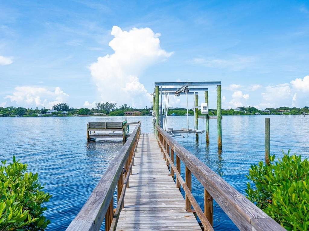Bay Front dock with 2 boat lifts - Single Family Home for sale at 1716 Bayshore Dr, Englewood, FL 34223 - MLS Number is A4445961