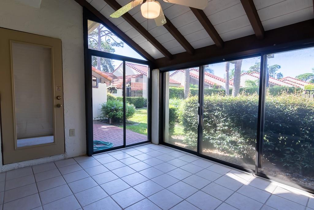 Enclosed Lanai lets the sun shine in! - Condo for sale at 5322 Huntingwood Ct #35, Sarasota, FL 34235 - MLS Number is A4446793