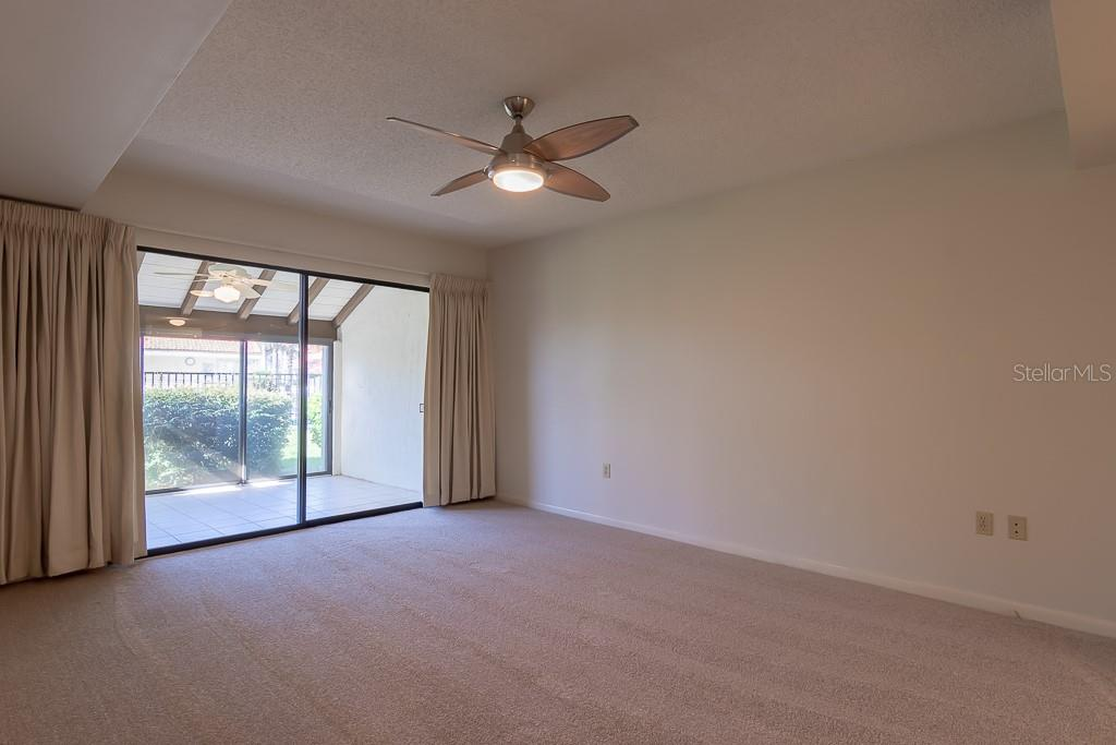 Master Bedroom with access to Lanai - Condo for sale at 5322 Huntingwood Ct #35, Sarasota, FL 34235 - MLS Number is A4446793