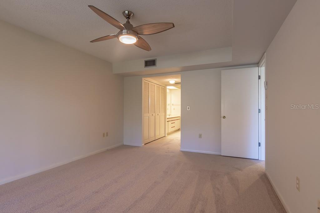 High ceilings in master bedroom - Condo for sale at 5322 Huntingwood Ct #35, Sarasota, FL 34235 - MLS Number is A4446793