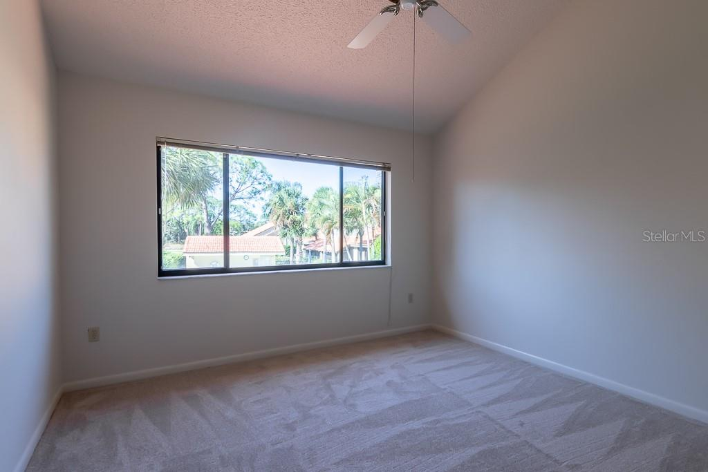 Bedroom overlooks the pool! - Condo for sale at 5322 Huntingwood Ct #35, Sarasota, FL 34235 - MLS Number is A4446793