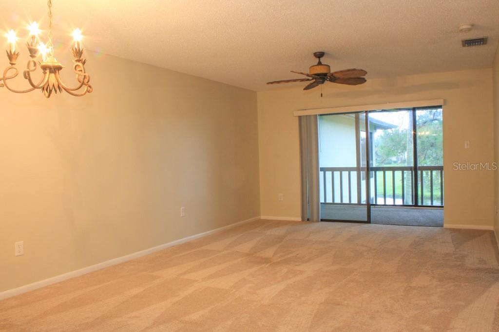 Entrance to glass-enclosed lanai - Condo for sale at 5131 Willow Links #10, Sarasota, FL 34235 - MLS Number is A4447477