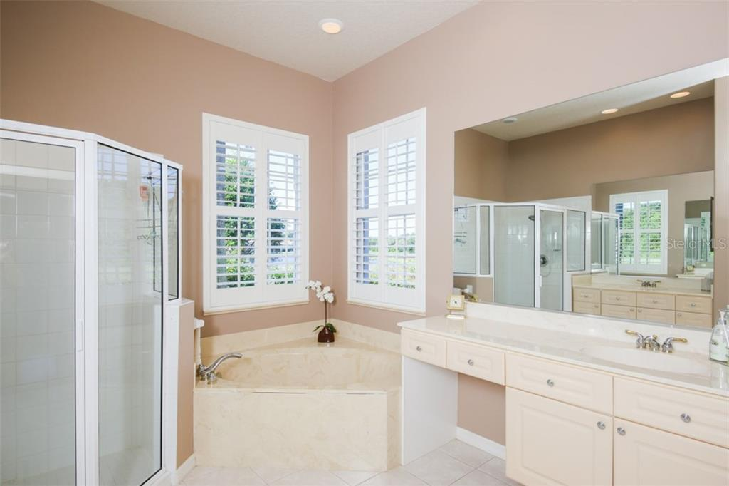 Master Bath with Shower, tub and double vanity - Single Family Home for sale at 6226 Stillwater Ct, University Park, FL 34201 - MLS Number is A4447872