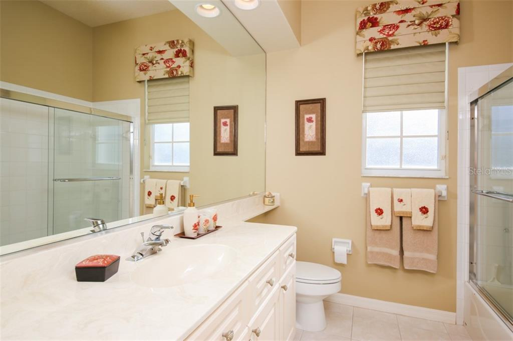Guest bath - Single Family Home for sale at 6226 Stillwater Ct, University Park, FL 34201 - MLS Number is A4447872