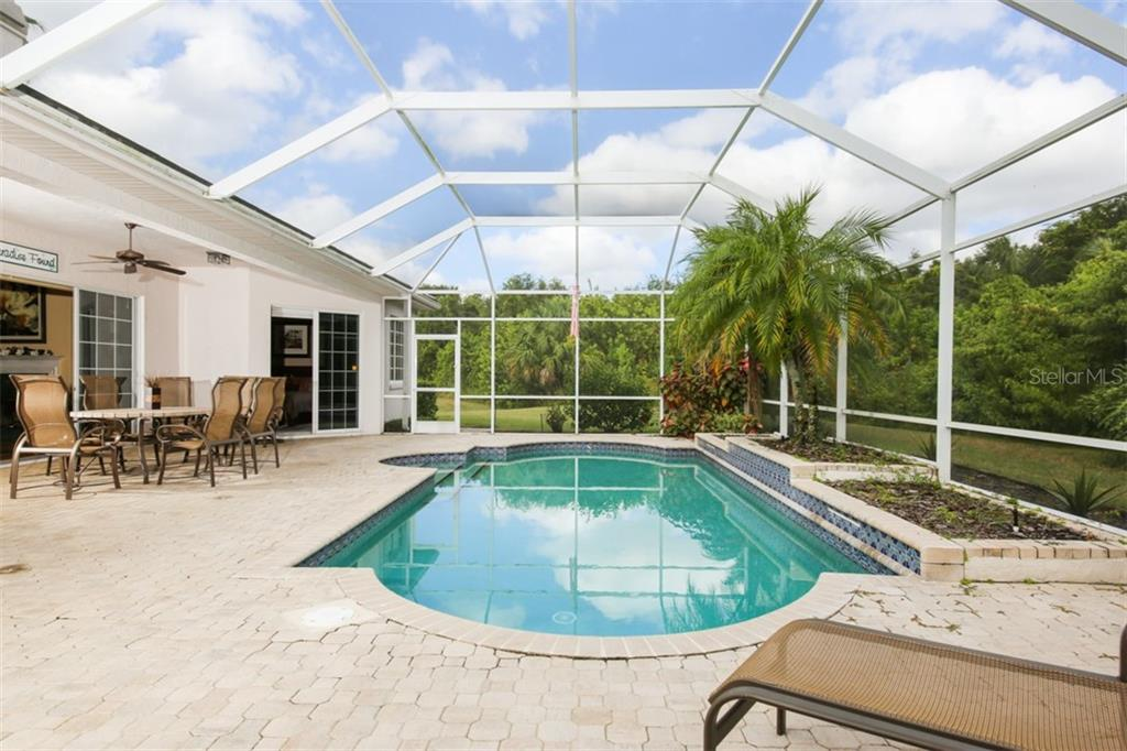 Pool with surrounding planters and access to living room and master - Single Family Home for sale at 6226 Stillwater Ct, University Park, FL 34201 - MLS Number is A4447872