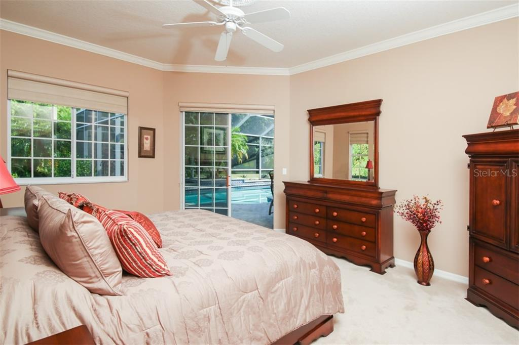 Master Bedroom with slider to pool - Single Family Home for sale at 6226 Stillwater Ct, University Park, FL 34201 - MLS Number is A4447872