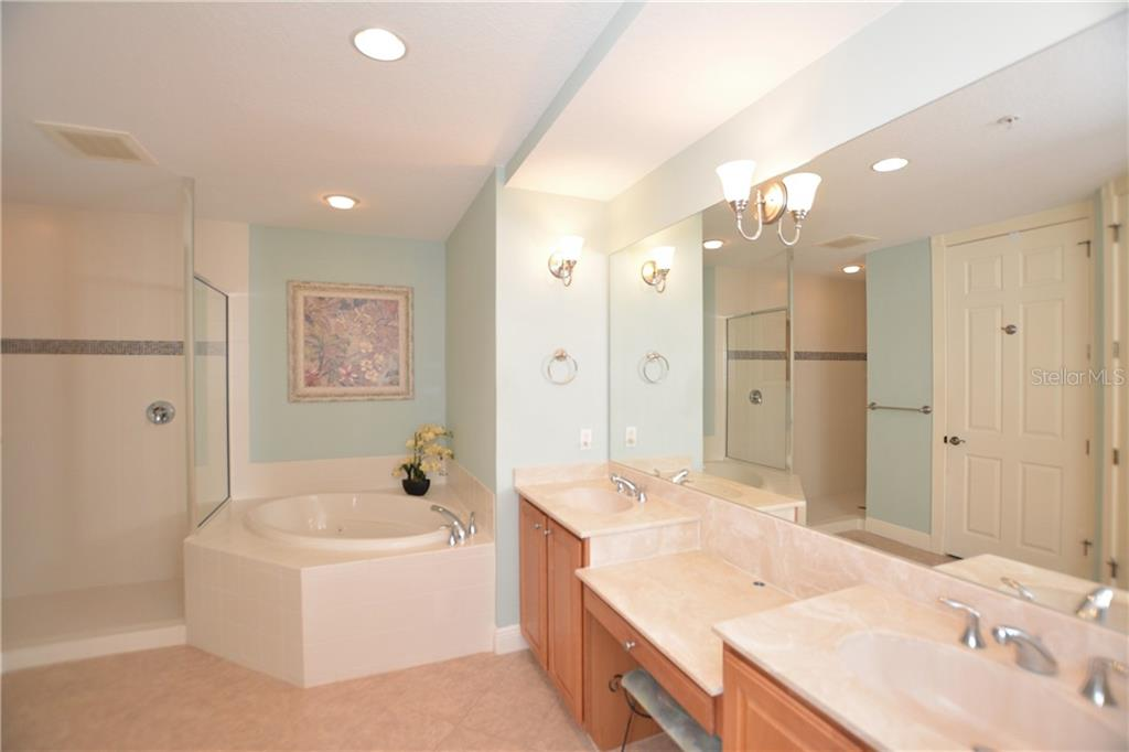 Master Ensuite Bath - Condo for sale at 5304 Manorwood Dr #2b, Sarasota, FL 34235 - MLS Number is A4448585