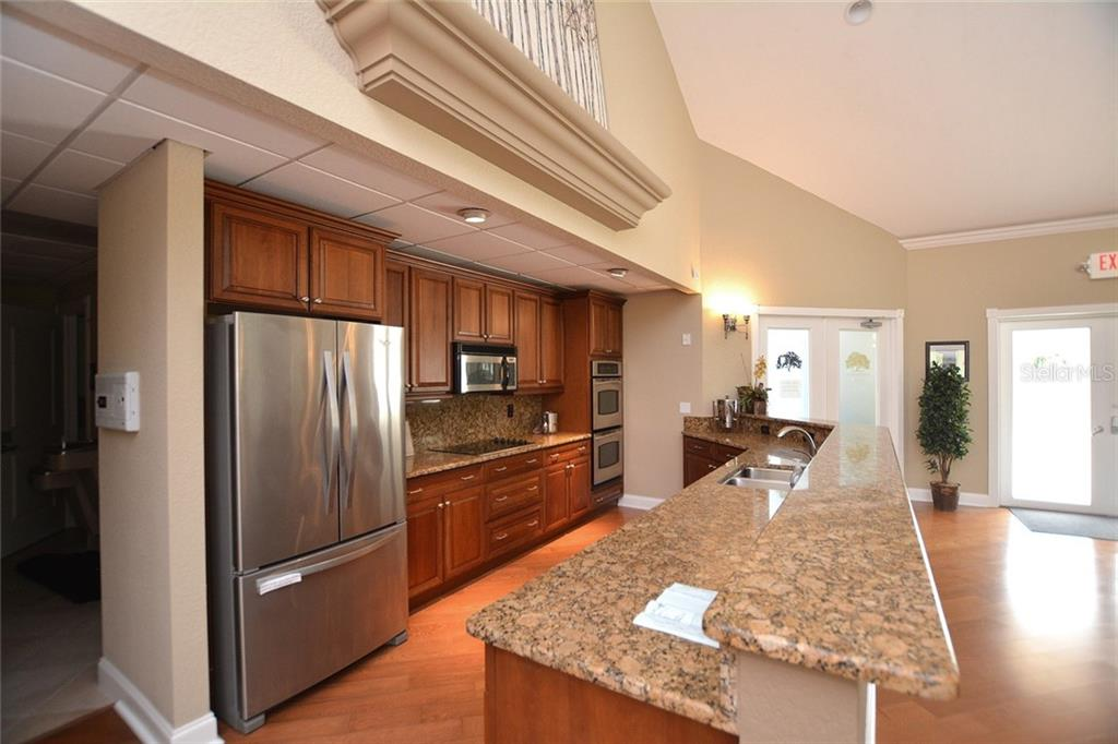 Community Kitchen - Condo for sale at 5304 Manorwood Dr #2b, Sarasota, FL 34235 - MLS Number is A4448585