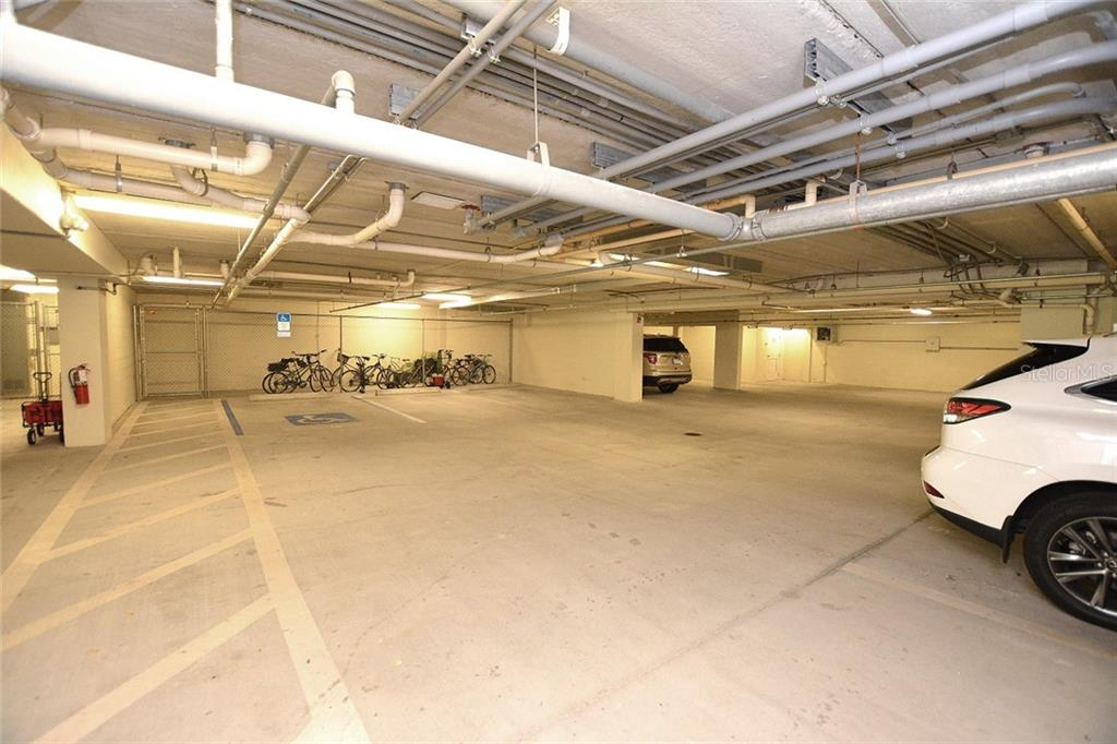 Community garage offers 1 reserved parking space & air conditioned storage area. - Condo for sale at 5304 Manorwood Dr #2b, Sarasota, FL 34235 - MLS Number is A4448585