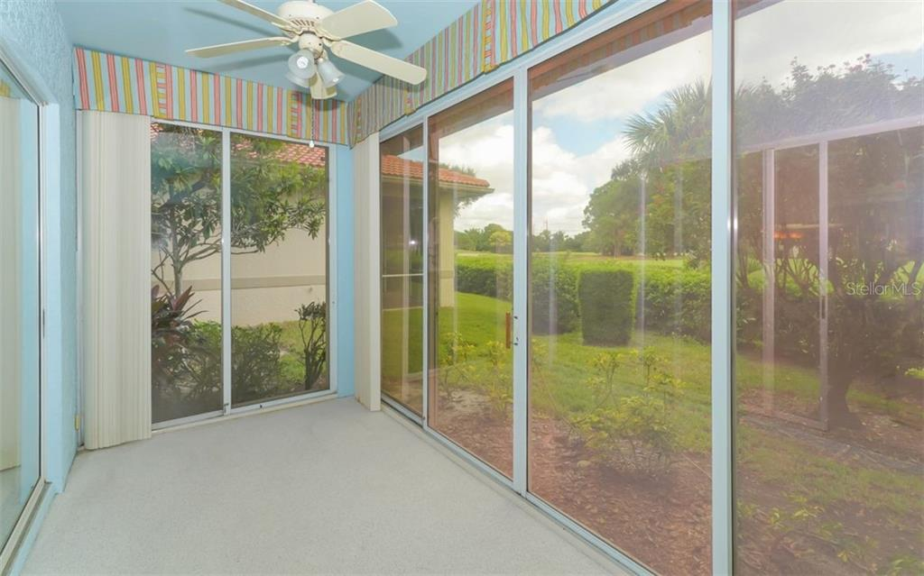 Florida Room can be AC or closed off and become a screen room with lake and golf course views - Villa for sale at 3338 W Chelmsford Ct, Sarasota, FL 34235 - MLS Number is A4448872