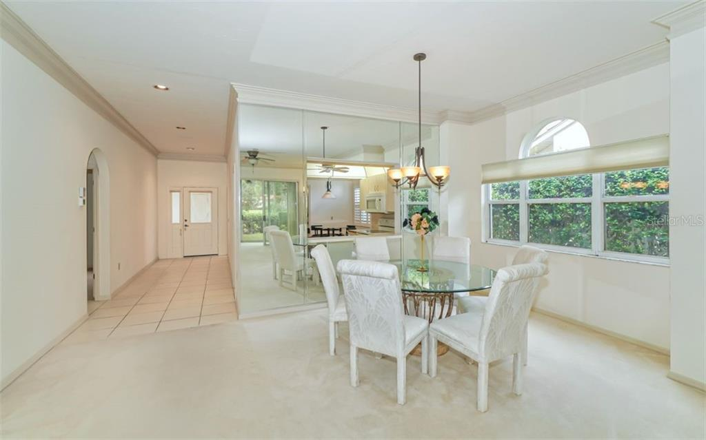 Light and Bright with Kitchen Pass Thru - Villa for sale at 3338 W Chelmsford Ct, Sarasota, FL 34235 - MLS Number is A4448872