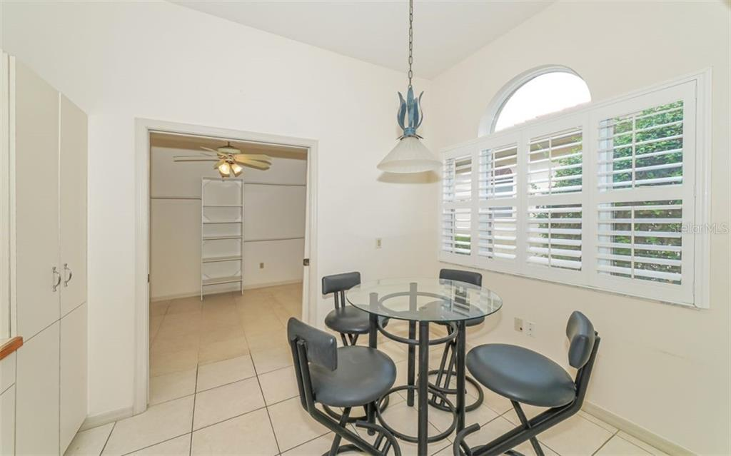 Eat in Kitchen / Office has Pocket doors - Villa for sale at 3338 W Chelmsford Ct, Sarasota, FL 34235 - MLS Number is A4448872